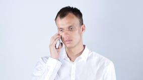 画象英俊,学生,快乐的人谈话在电话 库存照片