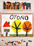 画:与黄色和桔子叶子的西班牙词秋天、房子和树 免版税库存图片
