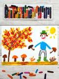 画:微笑的人采摘蘑菇在秋天森林里 库存照片