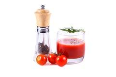 番茄汁、蕃茄和胡椒 免版税库存照片