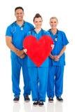 医疗保健工作者心脏标志 免版税库存图片