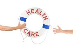 医疗保健救生圈到达手的圆环帮助 免版税库存照片