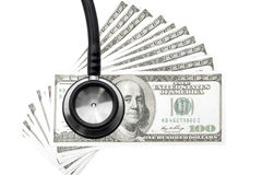 医疗保健费用 医疗保健的听诊器和金钱标志 库存照片