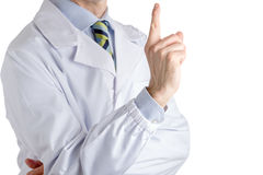 医疗外套的人指向与右食指的 免版税图库摄影