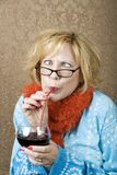 疯狂的饮用的酒妇女 库存照片