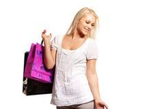 疯狂购物的俏丽的妇女 库存图片