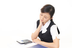 疲乏的亚裔女商人 免版税图库摄影