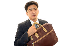 疲乏的亚洲商人 图库摄影