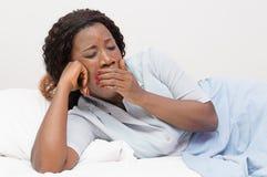 疲乏的妇女年轻人 库存照片