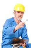 疲乏的成人工作者 免版税库存图片