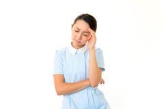 疲乏的护士 免版税库存图片