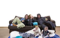 疲乏的父母和杂乱孩子 免版税图库摄影