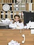 疲乏的年轻企业女孩 免版税库存照片