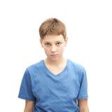 疲乏的年轻男孩的画象 库存图片