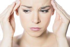 头疼妇女 免版税图库摄影