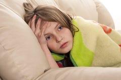病和不满意的孩子 免版税库存照片