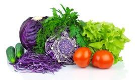 刻痕无头甘蓝、蕃茄、黄瓜和绿色 免版税库存图片