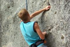 登山人岩石 库存图片