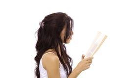 登记女孩查出的读取 免版税库存图片