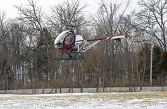登陆小的雪的域直升机 免版税库存照片