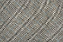 黑白与在正方形的蓝色houndstooth样式 免版税库存照片