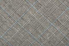 黑白与在正方形的蓝色houndstooth样式 免版税库存图片