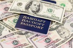白俄罗斯语护照和钞票有木甲板背景 免版税图库摄影