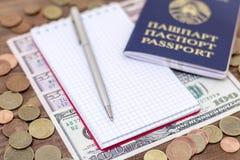 白俄罗斯语护照和钞票有木甲板背景 免版税库存图片