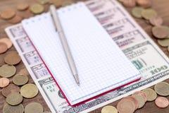 白俄罗斯语护照和钞票有木甲板背景 库存图片