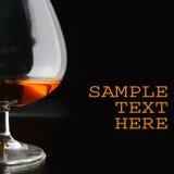 白兰地酒玻璃空间文本 免版税库存照片