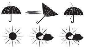 黑白天气符号伞和太阳 免版税库存图片