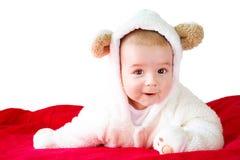 白熊服装的婴孩 免版税库存照片