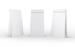 白皮书在与裁减路线的白色隔绝的午餐袋子 库存照片