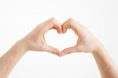 白种人人的手心脏形状的  免版税库存照片