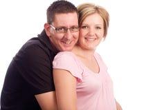 白种人夫妇愉快的怀孕的年轻人 免版税库存图片