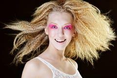 白肤金发与粉红色组成 库存照片
