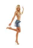 白肤金发在牛仔布裙子和比基尼泳装#2 库存照片