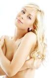 2白肤金发微笑露胸部 免版税库存图片