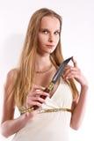 白肤金发的匕首女孩藏品年轻人 免版税库存照片
