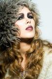 白肤金发的卷发妇女 免版税库存图片