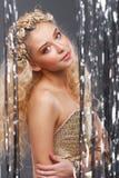 白肤金发的卷曲女孩头发 免版税图库摄影