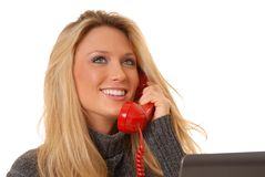 白肤金发的可爱的电话妇女 库存照片