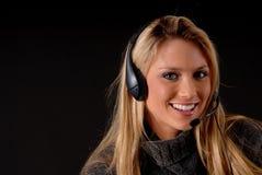 白肤金发的可爱的电话妇女 图库摄影