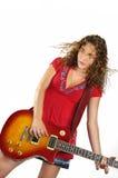 白肤金发的吉他弹奏者妇女 库存照片