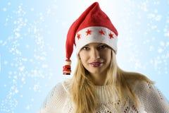 白肤金发的圣诞节女孩帽子 库存照片