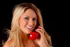 白肤金发的女孩可爱的电话 库存照片