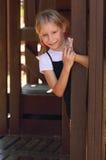 白肤金发的女孩少许操场 免版税图库摄影