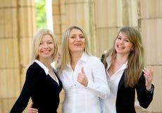 白肤金发的女孩微笑的三 免版税库存图片