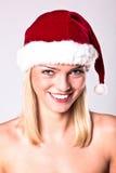 白肤金发的女孩性感的圣诞老人 库存图片