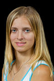 白肤金发的女孩查出的纵向微笑 免版税库存照片